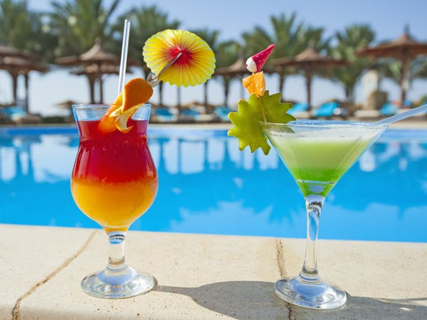 Cocktails on the side of a pool