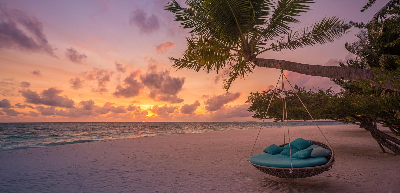 swing chair on a sunset lit beach